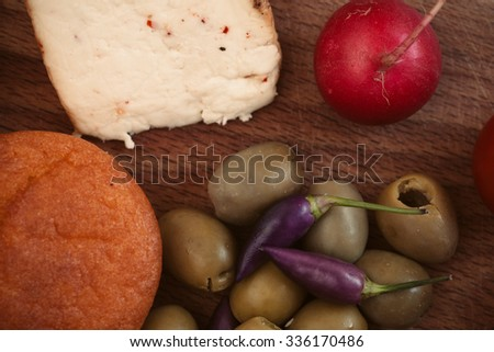 Breakfast with bread, radish, olives and cheese. - stock photo