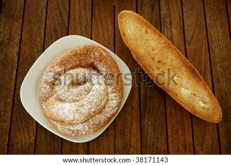 Breakfast with bread toast and ensaimada pastry from Spain - stock photo