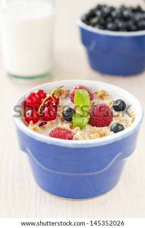 Breakfast with cereals and fresh berries