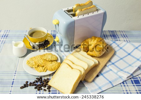 Breakfast with coffee,croissant,cookies and bread - stock photo