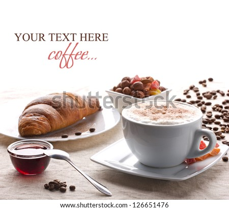 breakfast with coffee, croissant, nut and jam on white tablecloth on white background