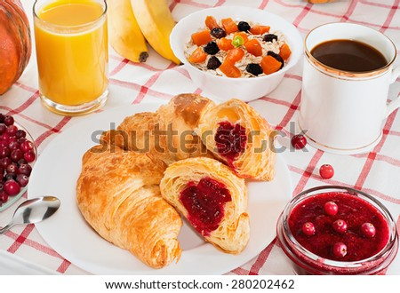 Breakfast with coffee, croissants, juice and fruit - stock photo