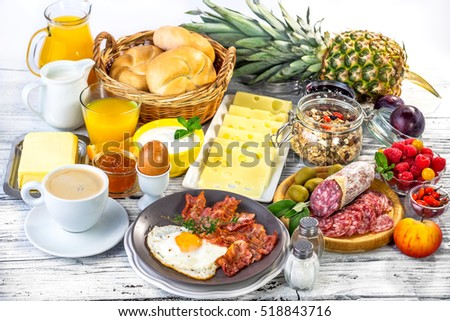 Breakfast with coffee, orange juice, croissant, egg, yogurt,vegetables,fruits ...
