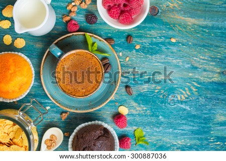 Breakfast  with coffee, raspberries and muffin. Food background with copyspace - stock photo