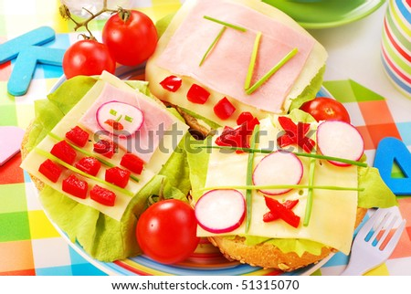 breakfast with cottage cheese for child with funny shape sandwich - stock photo