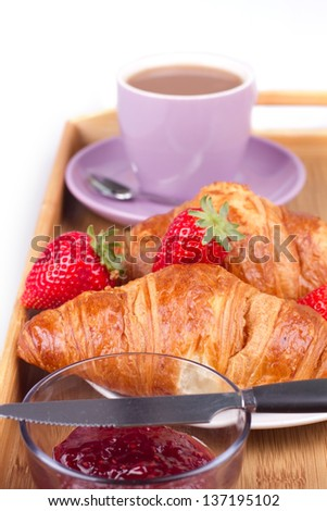 Breakfast with croissant on a tea tray