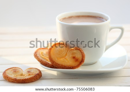 Breakfast with cup of cocoa and biscuits - stock photo