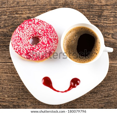 breakfast with donut and coffee - stock photo