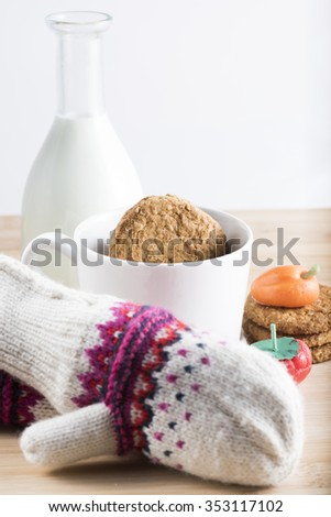 Breakfast with fresh milk, biscuits and candy during the winter cold - stock photo