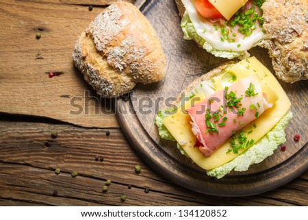Breakfast with fresh spring sandwiches - stock photo