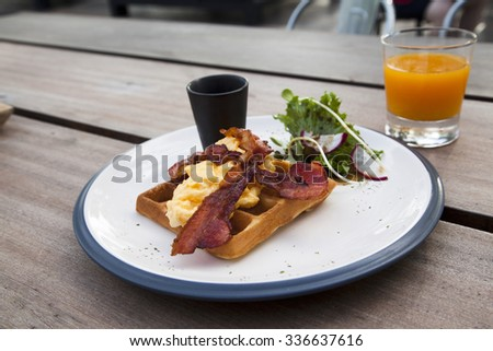 breakfast with fried eggs, bacon,waffle and fresh orange juice. - stock photo