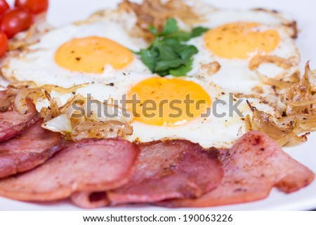 Breakfast with fried eggs beacon onion  - stock photo