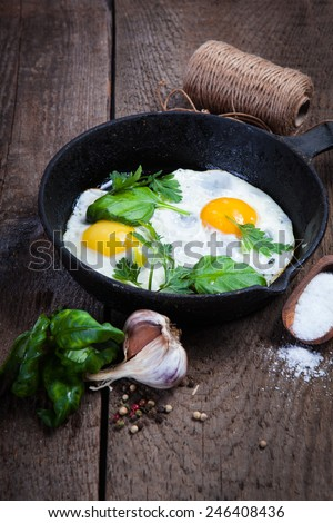 Breakfast with Fried eggs on pan - stock photo