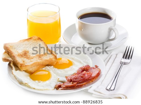 breakfast with  fried eggs, toasts, juice and coffee - stock photo
