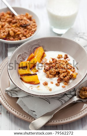 Breakfast with muesli,yogurt and grilled peaches