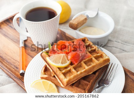 Breakfast with potato waffles and salted salmon - stock photo