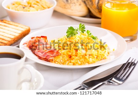 breakfast with scrambled eggs, toasts, juice and coffee