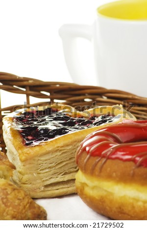 breakfast with sweet fruity pastry, focus on pastry layers - stock photo