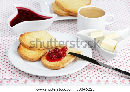 Breakfast with toasts, sour cherry jam, butter, and coffee