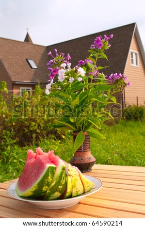 Breakfast with Water Melon in a Country house garden - stock photo