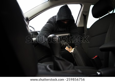breaking into a car - stock photo