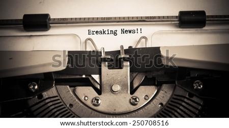 breaking news concept on typewriter  - stock photo