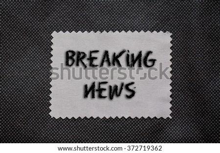 Breaking news words written on a chalkboard - stock photo