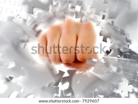 Breaking puzzle by knocking it to pieces. Photo-based graphic compositing. - stock photo