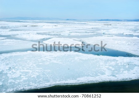 breaking spring ice floe - stock photo