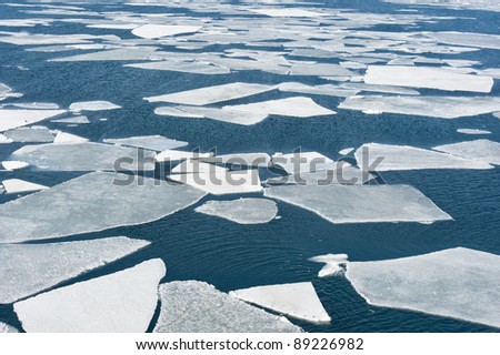 breaking spring ice floe at the sea - stock photo