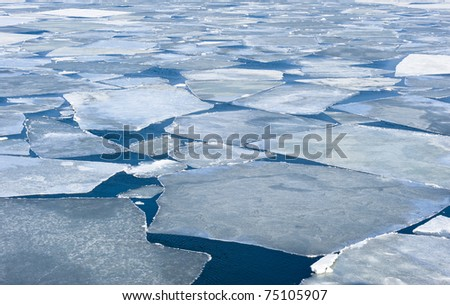 breaking spring ice floe of japanese sea - stock photo
