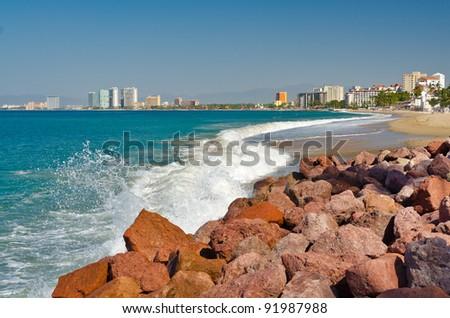 breaking wave on the beach in Puerto Vallarta, Mexico. - stock photo