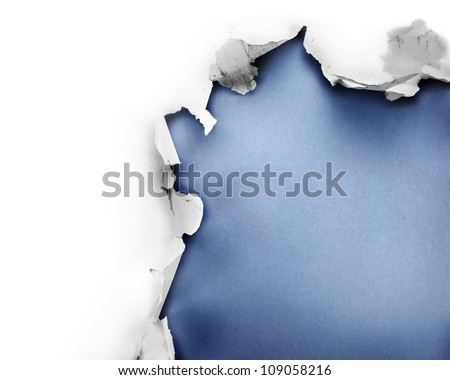 Breakthrough paper hole with blue background, isolated on white. - stock photo