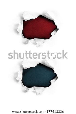Breakthrough paper holes on white. - stock photo