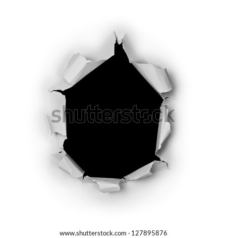 Breakthrough torn big black hole in rough paper isolated on white background. - stock photo