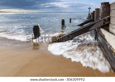 Breakwater and incoming waves showing motion and movement. Seaton Sluice. Northumberland, England, UK - stock photo