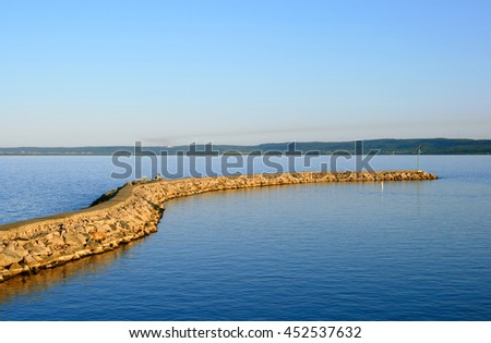 Breakwater at sunset. Lake St-Jean, Quebec, Canada.