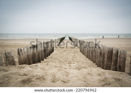 breakwaters  on the beach at the north sea in Domburg, Zeeland, Holland - stock photo