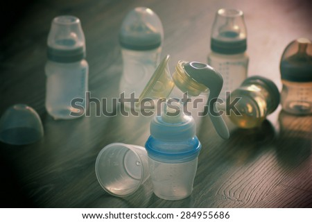 breast and baby bottles - stock photo