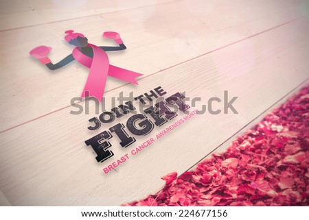 Breast cancer awareness message against autumn leaves against white wood - stock photo