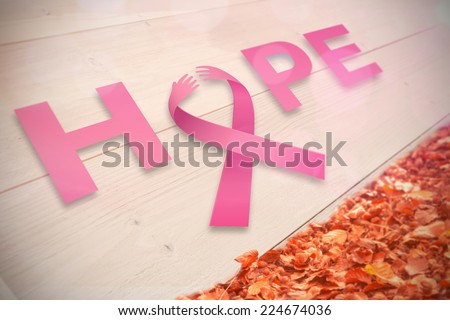 Breast cancer awareness message of hope against autumn leaves against white wood