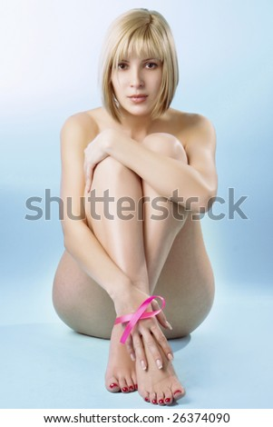 Breast cancer. Pink ribbon on a woman's breasts. Concept of medicine and health care - stock photo