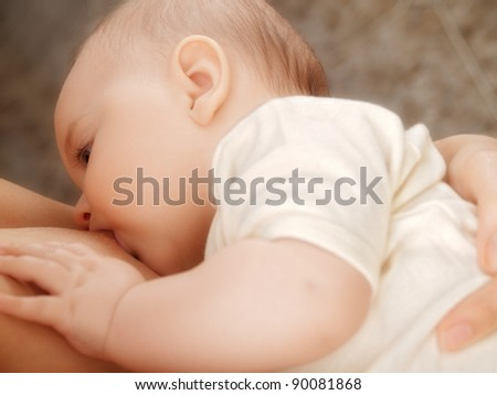 Breast feeding - stock photo