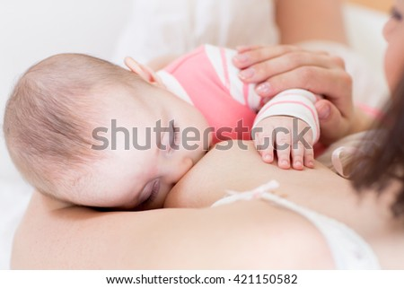 Breast feeding baby. Childcare and motherhood conception. - stock photo
