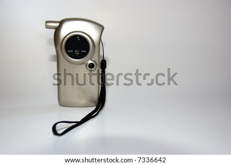 Breathalyzer against white background. - stock photo