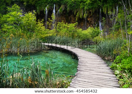 Breathtaking view in the Plitvice Lakes National Park .Croatia wallpaper background with footbridge, bridge - stock photo