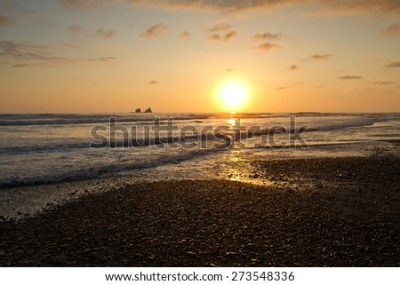 Breathtaking view of amazing sunset in a beautiful beach of Manabi, Ecuador - stock photo