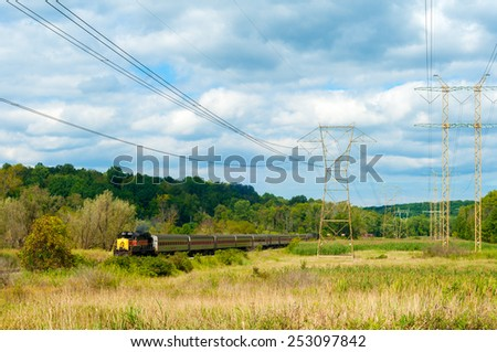 BRECKSVILLE, OH - SEPTEMBER 14, 2014: A diesel locomotive pulls a passenger train on the Cuyahoga Valley Scenic Railroad, a popular excursion line between Cleveland and Akron. - stock photo