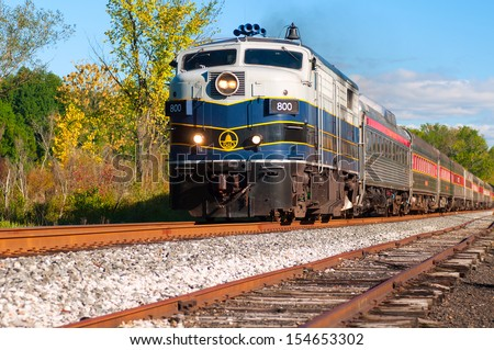 BRECKSVILLE, OH - SEPTEMBER 14: A passenger train on the Cuyahoga Valley Scenic Railroad passes through Brecksville Ohio on September 14 2013. The CVSR makes popular runs from near Cleveland to Akron. - stock photo