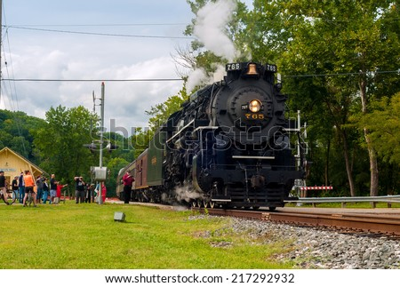 BRECKSVILLE, OH - SEPTEMBER 6, 2014: A passenger train pulled by the famous NKP-765 steam locomotive departs the Boston Mill station on the Cuyahoga Valley Scenic Railroad. - stock photo